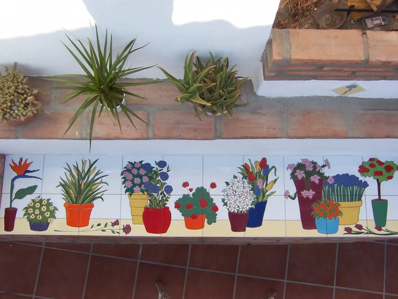 Murales con motivos florales murales de cer mica tiles for Ceramica decorativa pared
